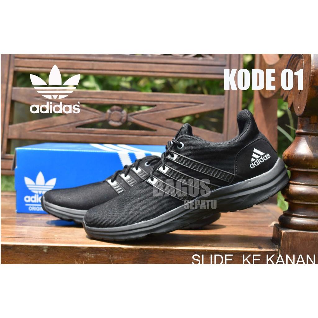 Sepatu Sneakers Olahraga Pria Model Adidas NMD Runner Human Warna Hitam  3f2008e083