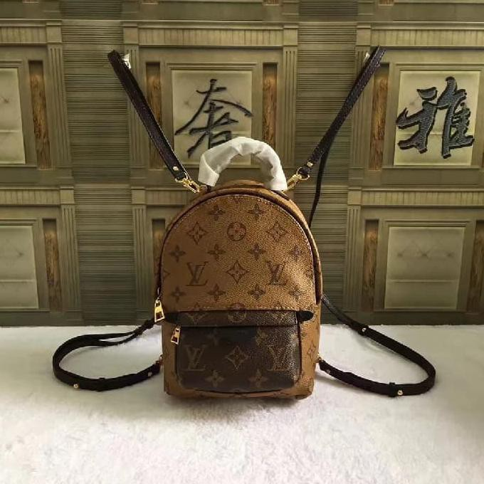 a7783b1c9275 LV Palm Spring Backpack Size Mini