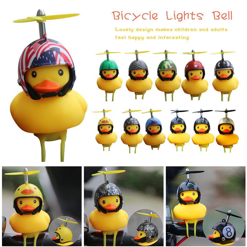 ✨[Bayar Di Tempat]Mode Lucu Kartun Balap Helm Memutar Bebek Kuning Kecil Anak Sepeda Bell Tik Tok CW