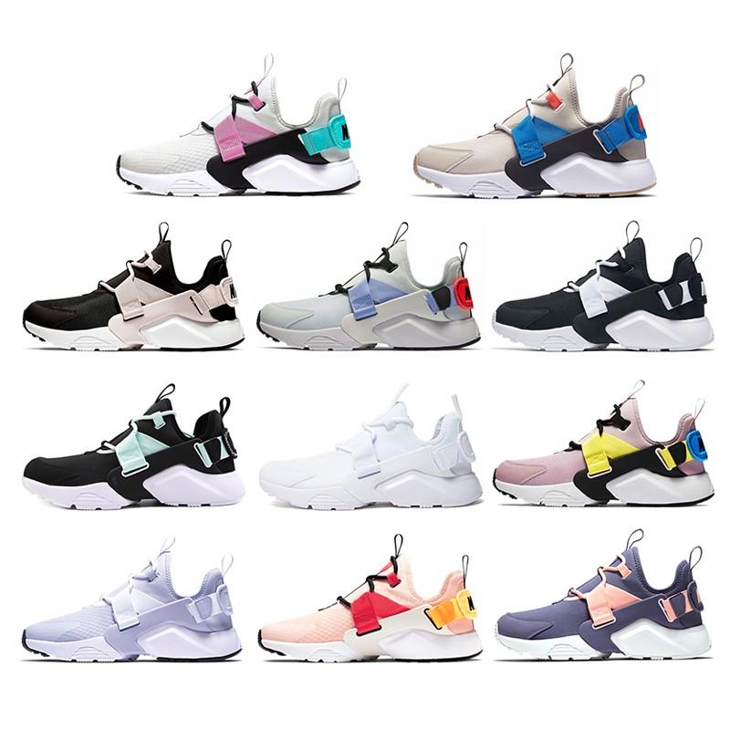 Sepatu Sneakers Desain Nike Air Huarache City Low Bahan Breathable Warna Hitam/pink Untuk Wanita
